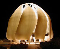 The night view of a model of the new Bah??House of Worship under construction in Chile, showing its translucent alabaster dome.
